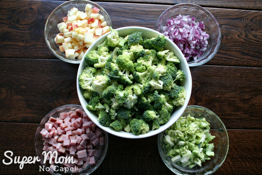 Broccoli Salad with Balsamic May Dressing - chopped broccoli, ham, onions and apples in bowls