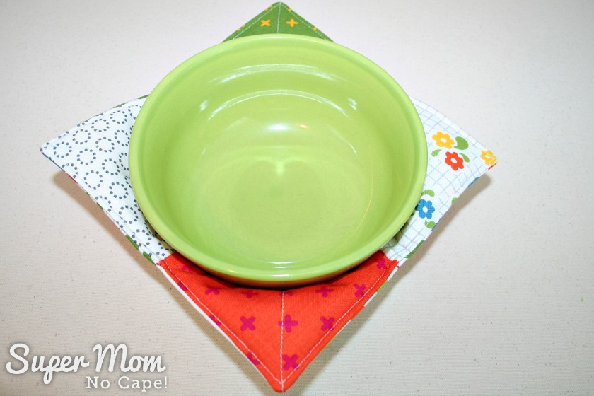 Charm Square Soup Bowl Cozy Tutorial -green bowl in reverse side of finished bowl cozy