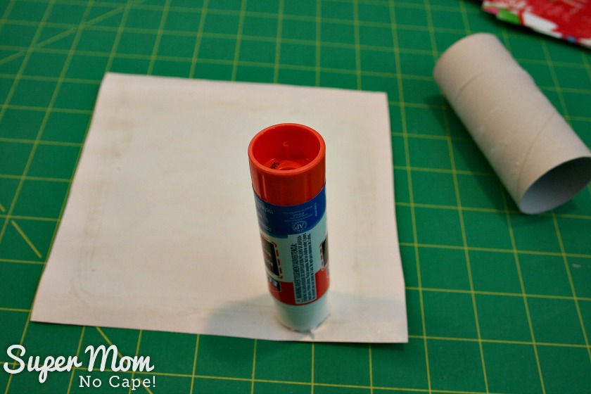 Halloween Treat to Christmas Party Favor - Apply glue to the back of the paper and along all four edges