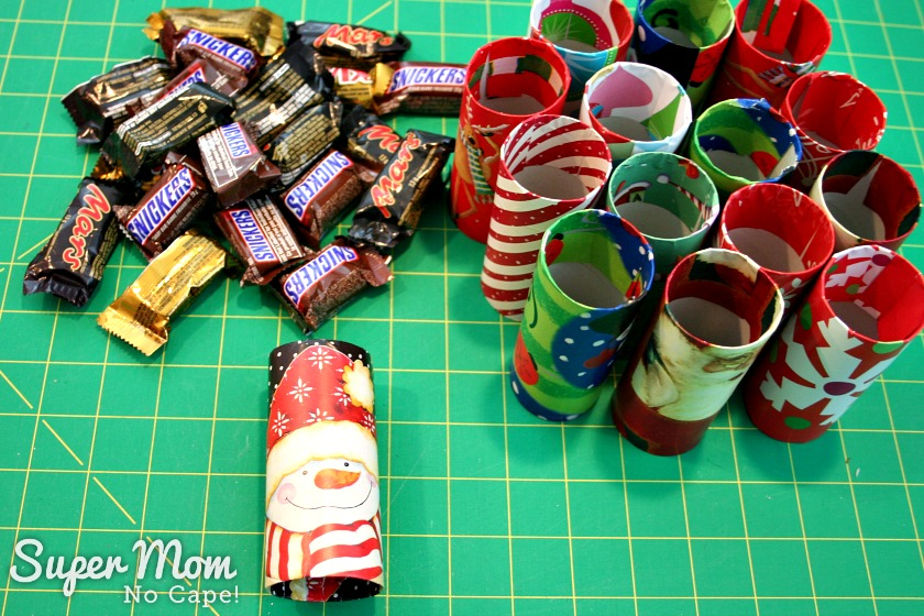 Halloween Treat to Christmas Party Favor - Tubes covered with Christmas wrapping paper ready for candy
