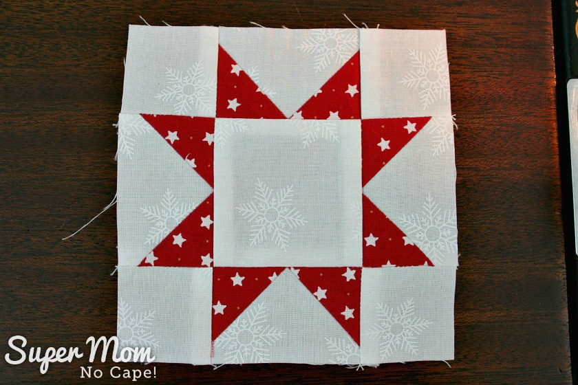 Sawtooth Star with Applique Center Ornament 22. Finished block