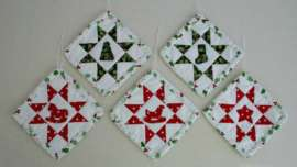 Five Sawtooth Star with Applique Center Ornament completed