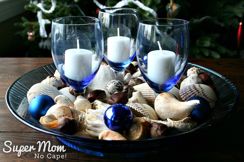 Elegant Beach Christmas Decor - Blue bowl of seashells with blue Christmas ornaments