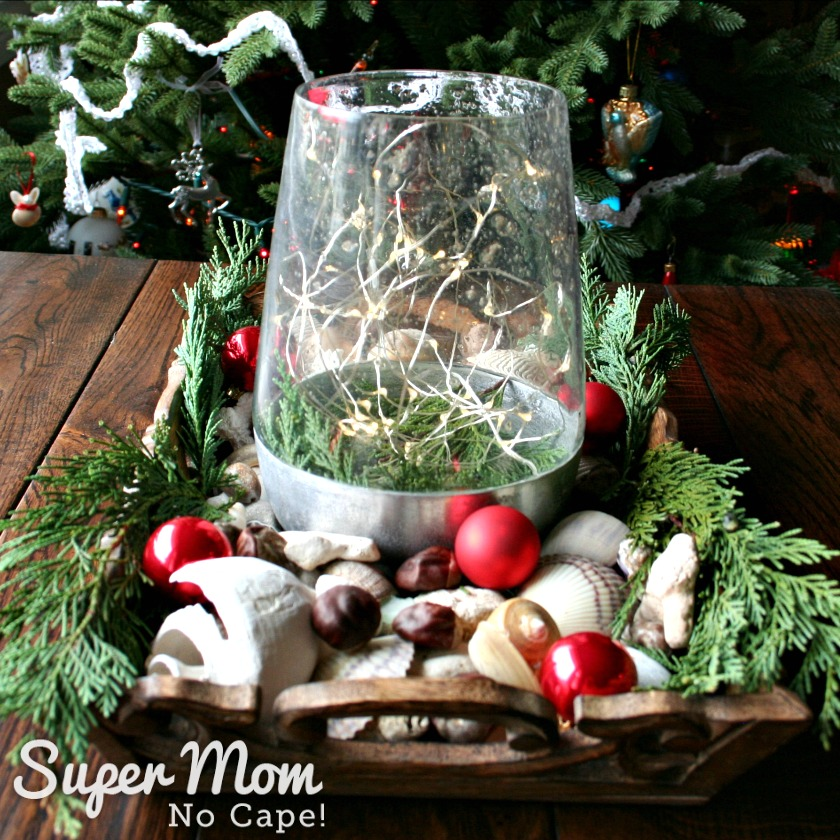 Elegant Beach Christmas Decor - Sea shells in wooden tray with lighted vase greenery and Christmas ornaments