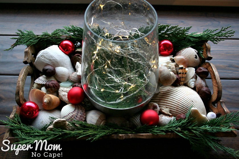 Elegant Beach Christmas Decor - Sea shells in wooden tray with lighted vase