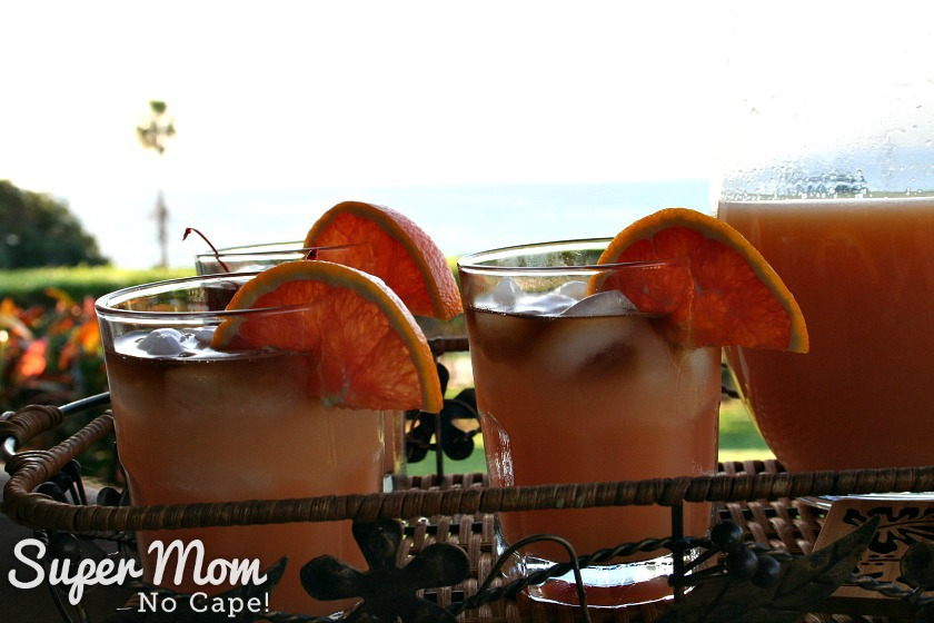 3 glasses Mai Tais being served on a wicker tray