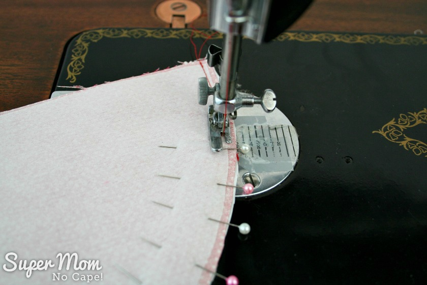 Sew along the curved edge using quarter inch seam allowance