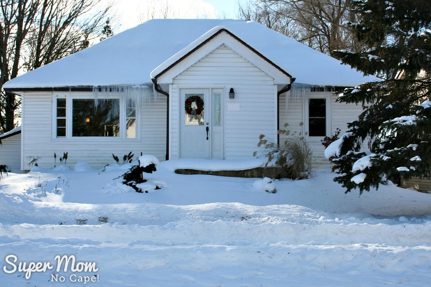 Our house with snow piled up