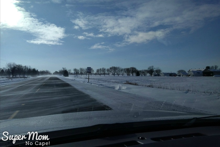Snow drifting across the highway