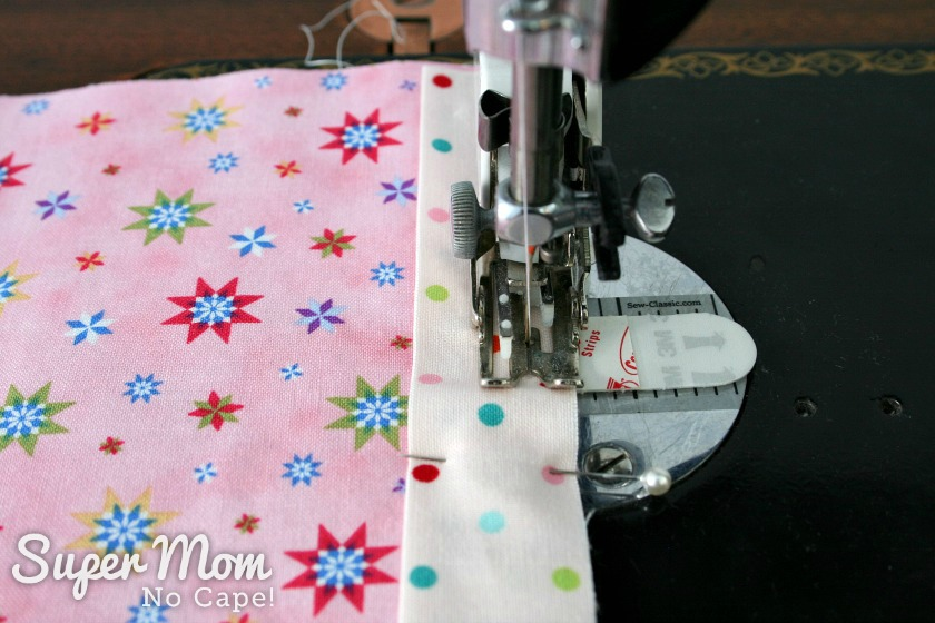 Sewing the short binding strip in place