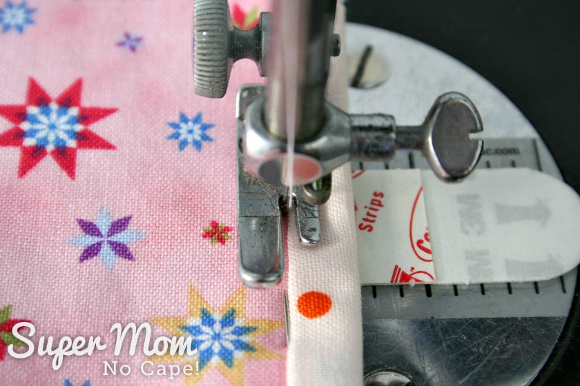 Photo of the binding being sewn in place