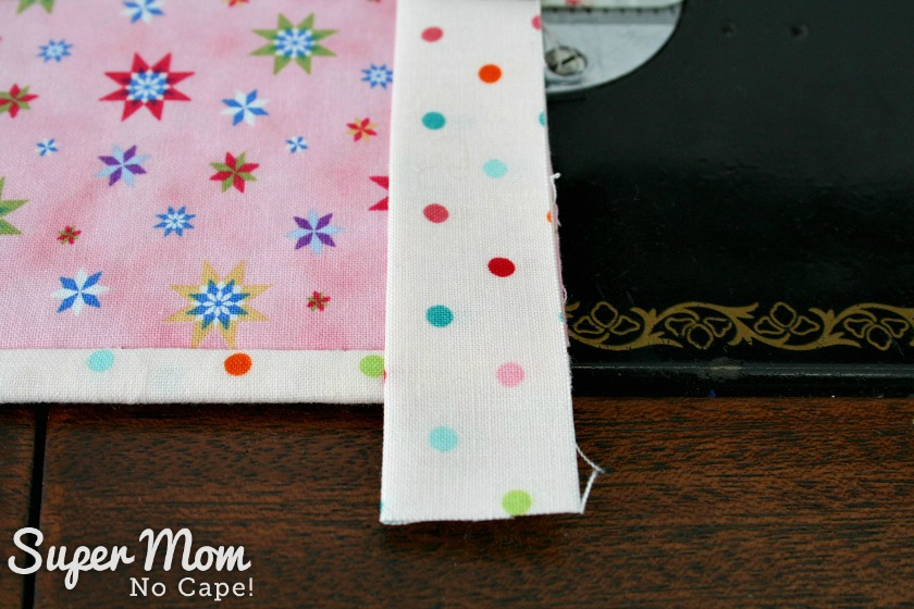 Trim binding leaving enough to turn under the end