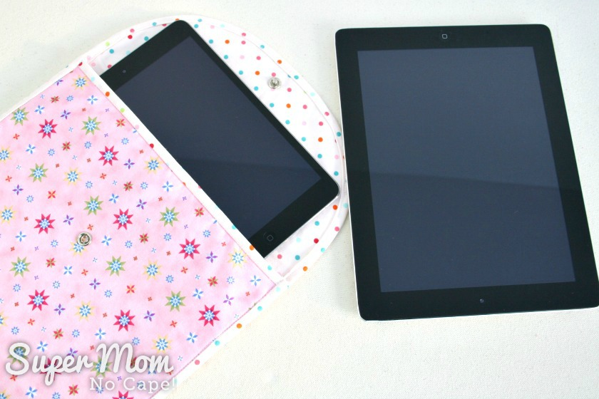 Photo showing iPad mini inserted half way into the pouch with iPad laying beside for comparison