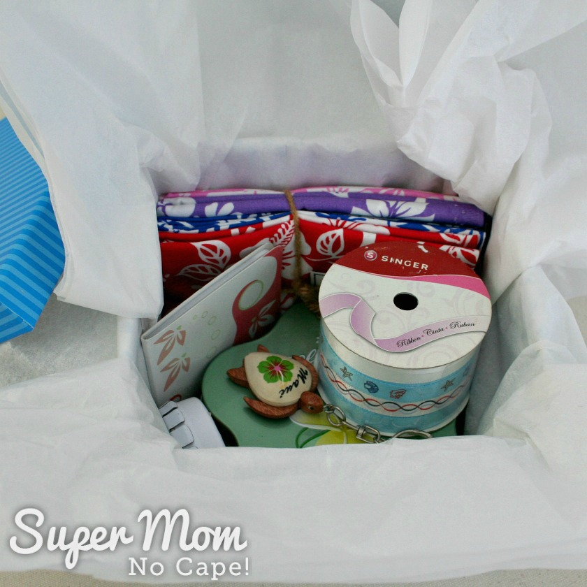 Box of prizes for the Aloha from Maui Giveaway with bonus items added