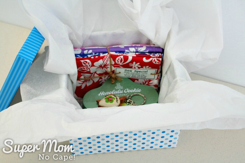 Prizes from the Aloha from Maui Giveaway in a box lined with tissue paper