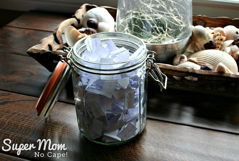 Slips of paper with giveaway entrants names on them in a jar