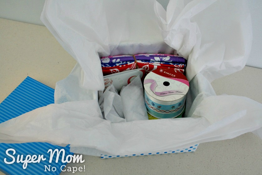 Small items wrapped in tissue and added to the box