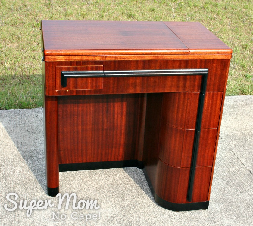 Photo taken outside of Singer Art Deco Cabinet after being refinished sitting