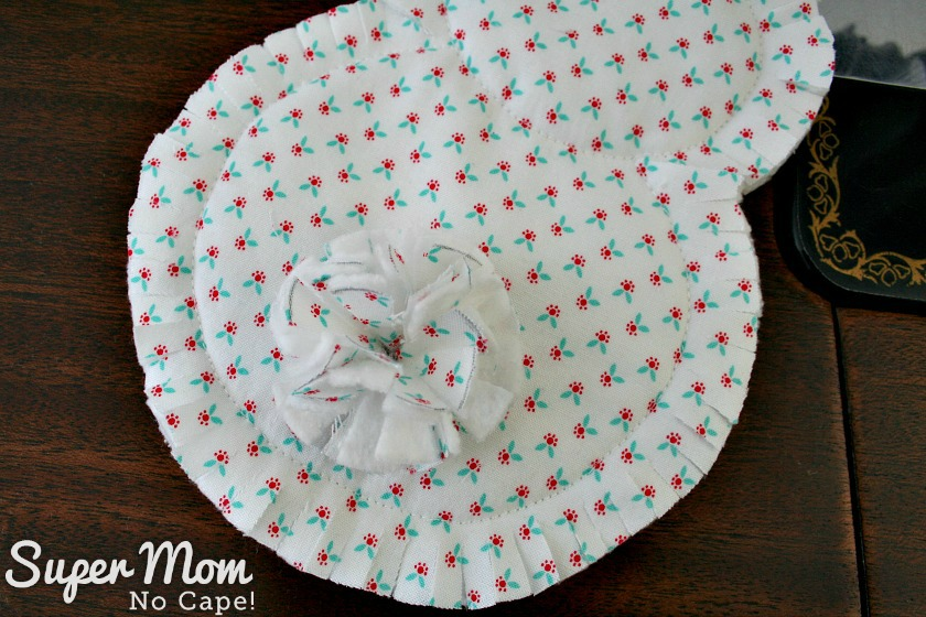 Sew tail to the back of the rag quilt bunny