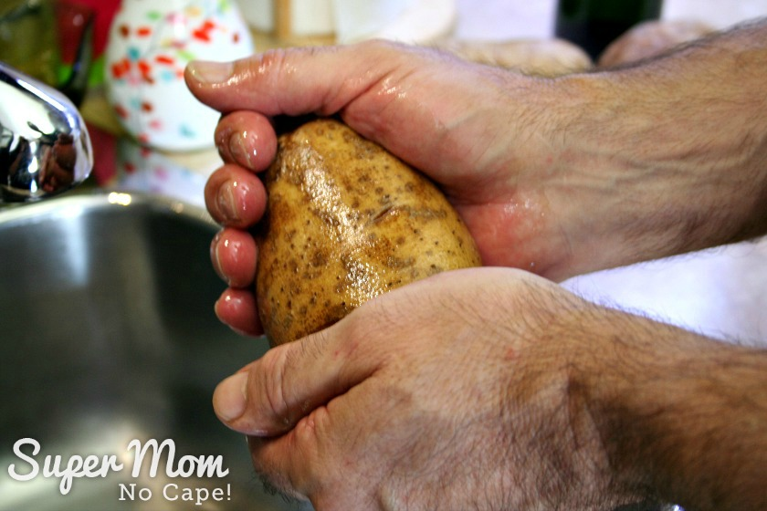 Coating the potato with olive oil before first baking of Twice Baked Potatoes