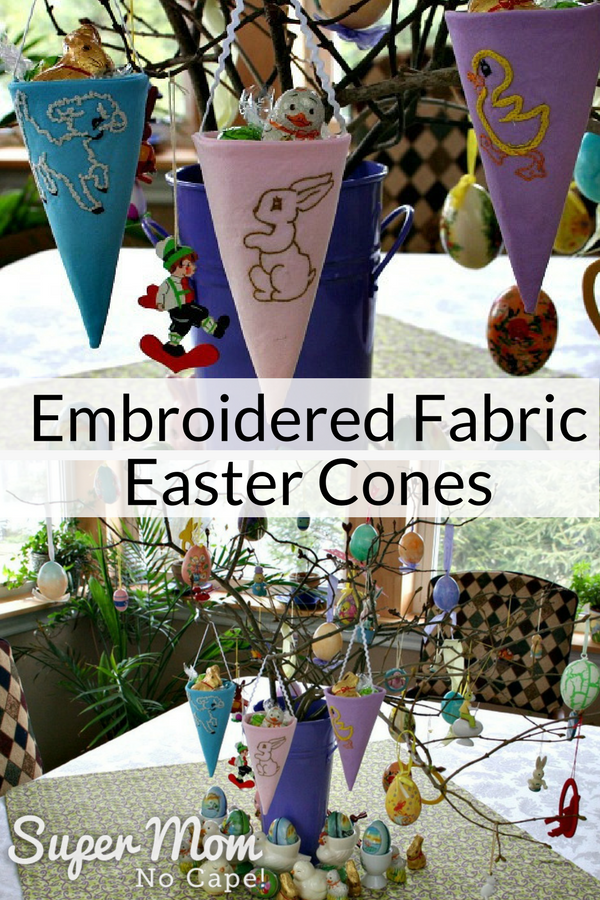 3 Embroidered Fabric Easter Cones hanging on branches along with other Easter decorations
