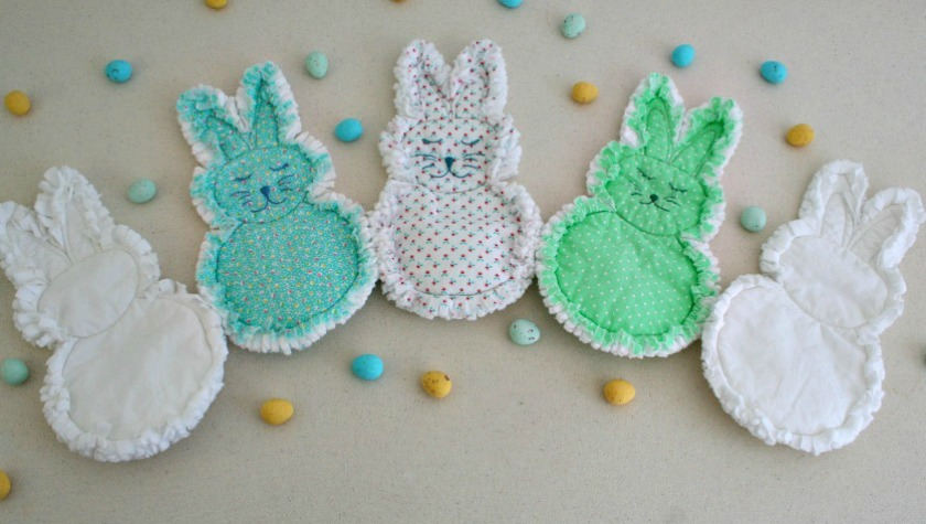 Photo of five rag quilt bunnies pictured with candy eggs