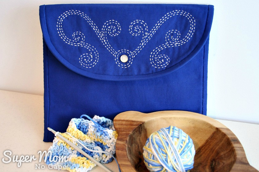 Making Waves Sashiko Embroidered Pouch pictured behind crocheted item and yarn bowl