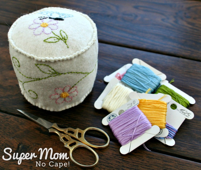Embroidered Butterfly pincushion, embroidery floss and scissors