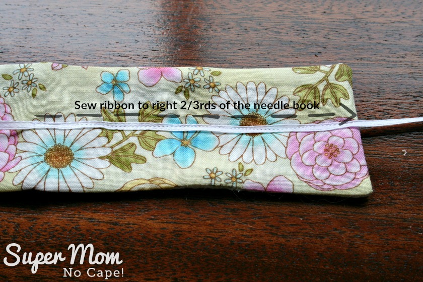 Narrow white ribbon sewn to outside of needle book for Glasses Case Sewing Kit