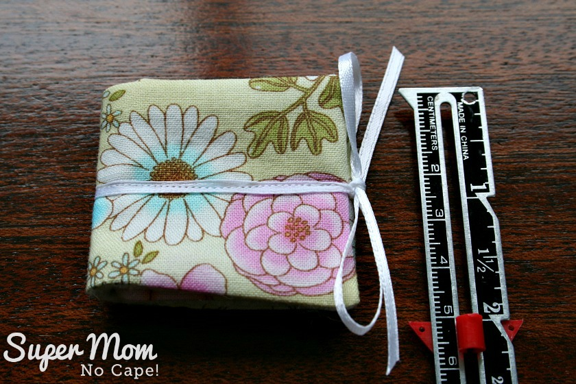 Trifold needle book for Glasses Case Sewing Kit tied with a white ribbon