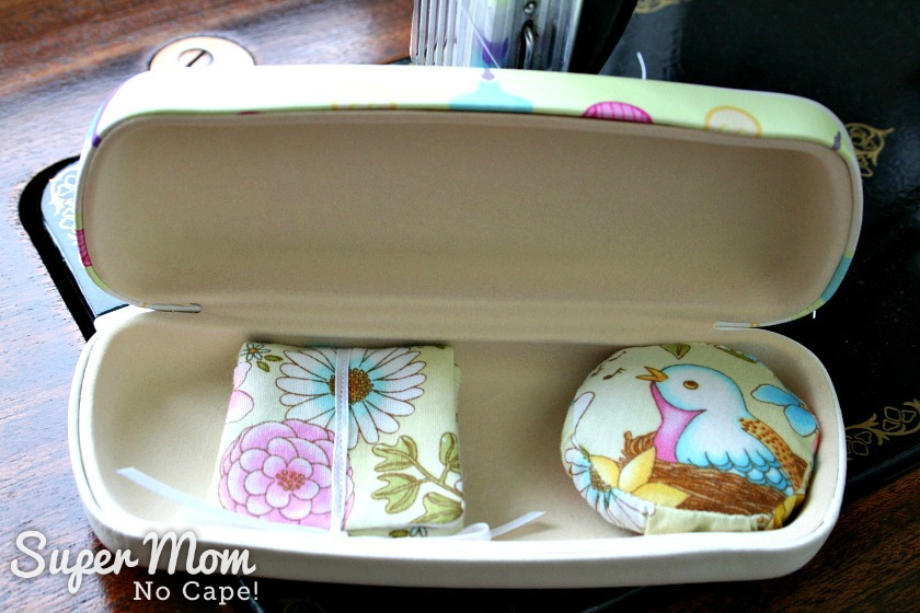 Needle book and pincushion inside sewing themed glasses case