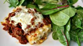 Close up of Lasagna Roll Ups in casserole dish after baking