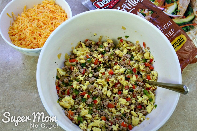 Ground pork, egg and veggie mixture in a large bowl to make Breakfast Burritos
