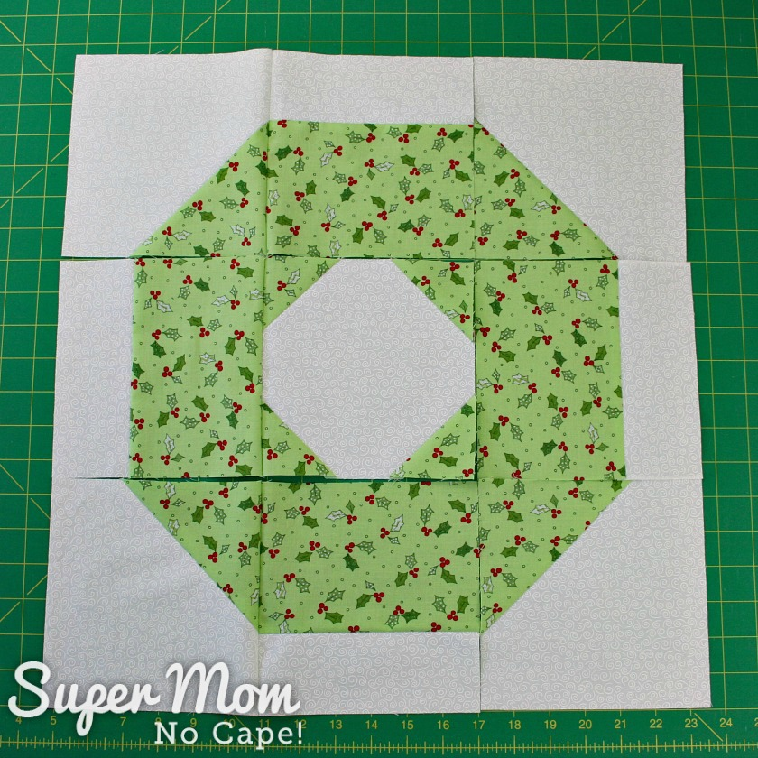 Christmas Wreath block with first two columns of blocks sewn together