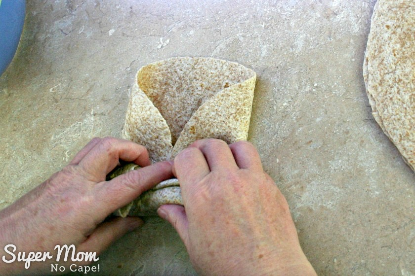 Fold over the right hand side of the tortilla