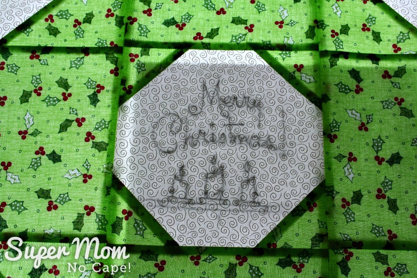 Tracing the embroidery pattern onto the Christmas Wreath block