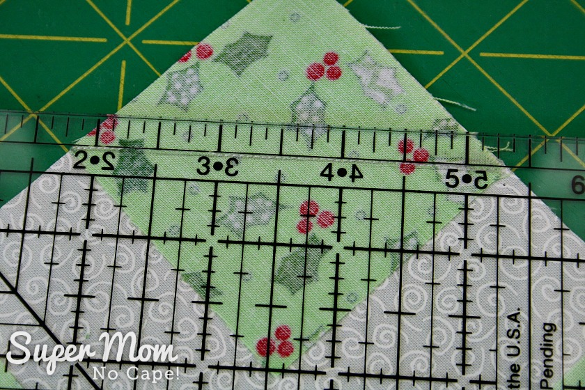 Use a ruler to measure and then trim quarter in seam allowance