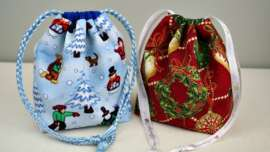 Two drawstring gift bags with divider