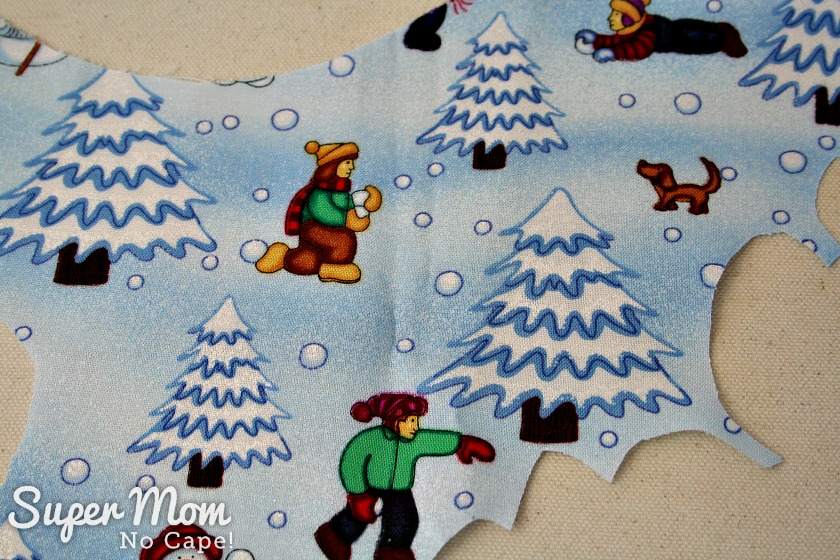 Scrap of Snowball Fight fabricabric used for applique on snowglobes