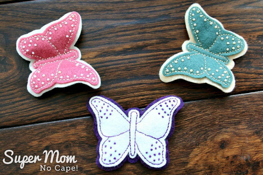 3 Felt Embroidered Butterflies on a wooden table