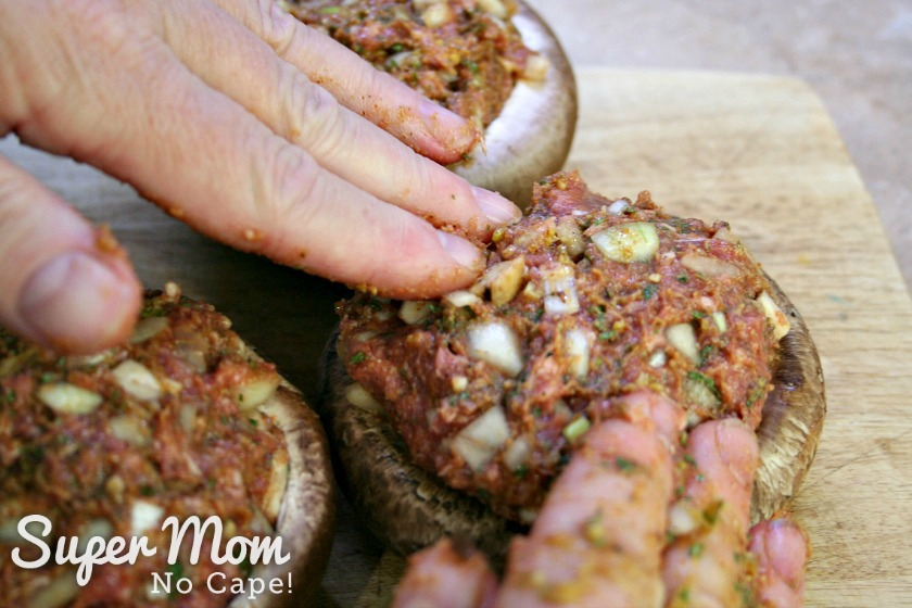 Stuffing the portobello mushroom with the lamb mixture