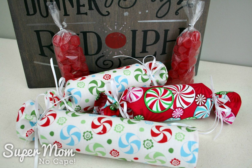 Small bags of red candy as filler for Fabric Christmas Crackers