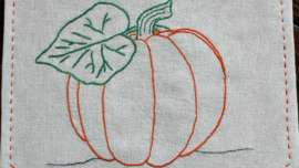 Embroidered Pumpkin Banner hanging on front door