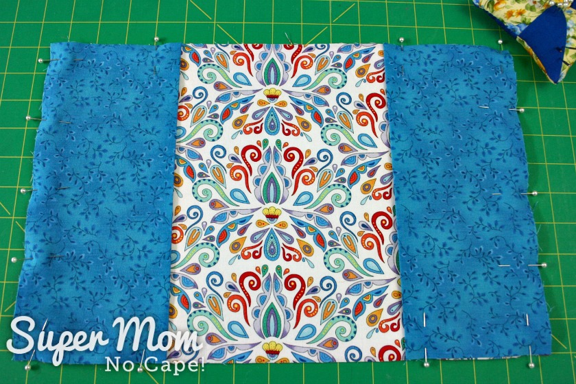 Flaps pinned to the outside of fabric book cover