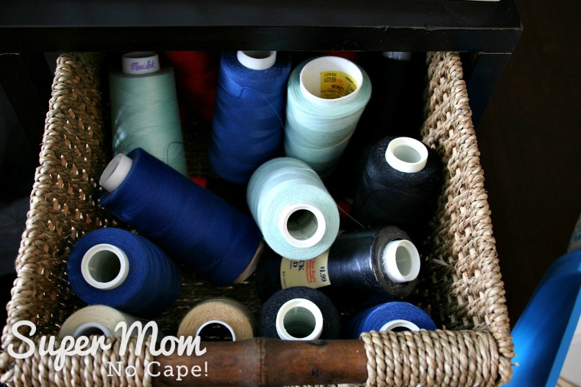 Serger spools in wicker basket drawer