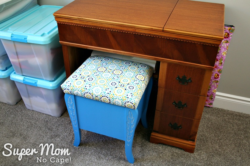 Thread storage stool in front of Kenmore sewing machine cabinet