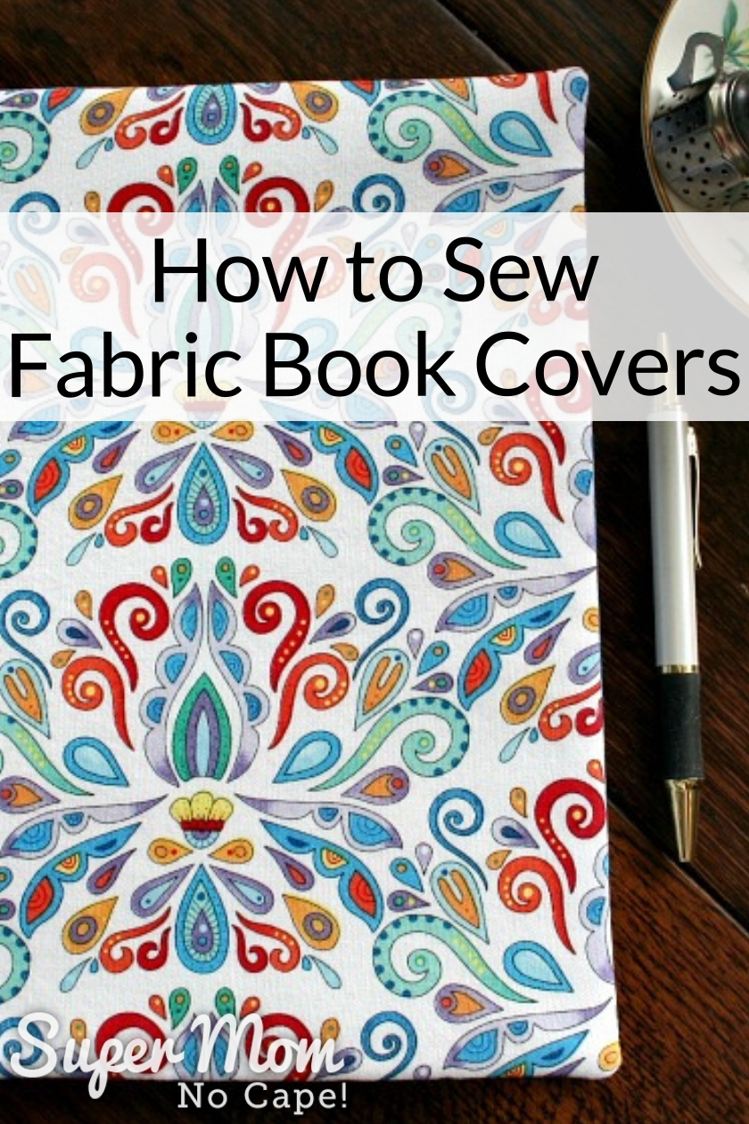 Pretty patterned Fabric Book Cover with pen beside it