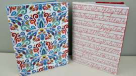 Two fabric book covers on composition books