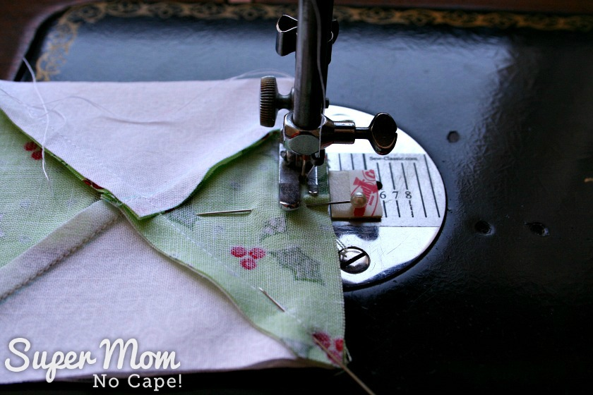 Sewing the hourglass blocks together for the Quilted Hourglass Candle Mat
