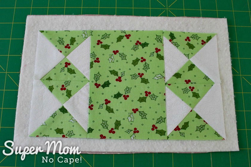 Candle mat top sandwiched with batting and backing
